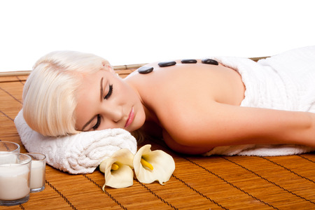 lastone: Beautiful young woman relaxing at spa getting therapeutic pampering lastone therapy.