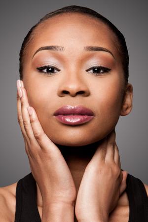 Beautiful face of black Asian blasian woman with cosmetics makeup, skincare concept. Imagens