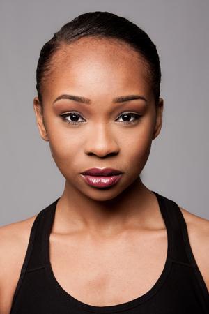 Beautiful face of black Asian blasian woman with cosmetics makeup.