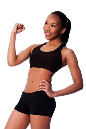 Beautiful healthy fit happy smiling celebrating black asian woman workout fitness and toned body.