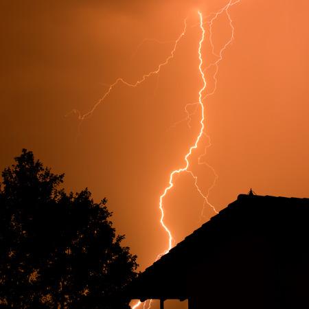 thunderbolt: Thunderbolt with house and tree Stock Photo