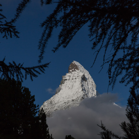 matterhorn: Matterhorn summit seen through trees Stock Photo