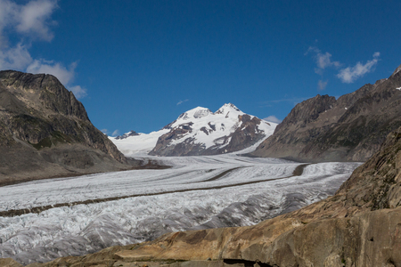 climatic: glacier Aletsch with blue sky and clouds Stock Photo