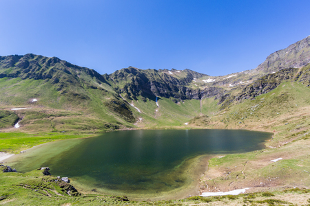 lake Tom (lago di Tom) in piora valley in ticino with blue sky Banco de Imagens