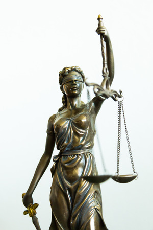 Justitia statue with blindfold, sword and balance, white background Stock Photo
