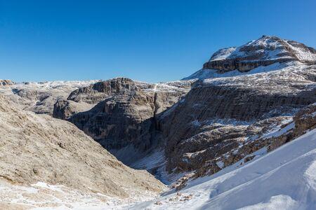 snowcapped Piz Boe mountain in  Dolomites, blue sky
