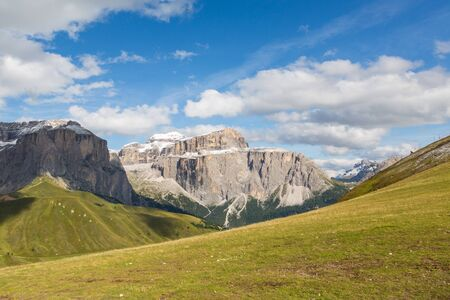 Sella mountain group with Piz Boe in Dolomites, cloudy blue sky