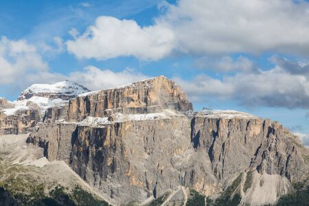 Sella group in Dolomites with Piz Boe mountain summit, cloudy blue sky Imagens - 131232881