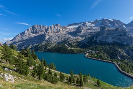 UNESCO world heritage Marmolada mountain and lake Fedaia in italian Dolomites