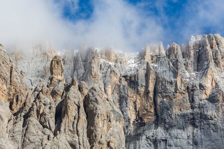 south face of UNESCO world heritage Marmolada mountain, cloudy blue sky Banco de Imagens