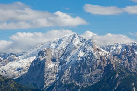 snowcapped Marmolada mountain peak in italian Dolomites during summer Banco de Imagens