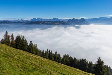 natural sea of fog and Swiss Mythen mountains in blue sky