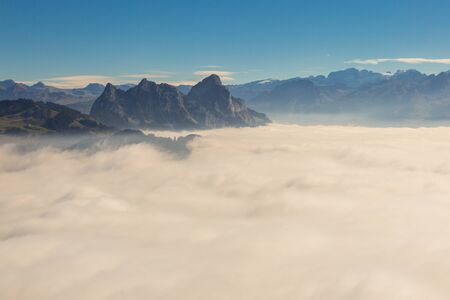 natural sea of fog blow Swiss Mythen mountains in evening light Imagens
