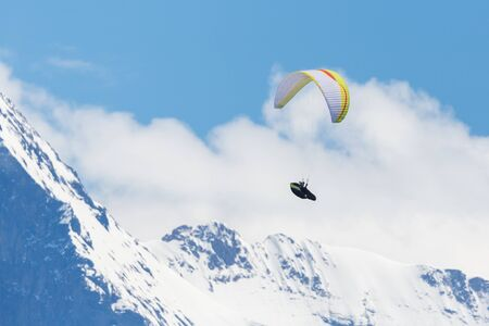 paraglider in flight in Swiss alps in Bernese highlands, mountains, snow Stock fotó