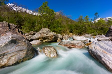 colorful Verzasca valley with natural green river water in spring, blue sky