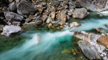 colorful stones and natural green water of Verzasca river in Ticino Switzerland