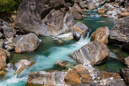 colorful natural stones and water of Verzasca river in Ticino Switzerland Stock fotó