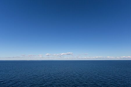 natural blue north sea with blue sky and stripes of clouds over horizon Stock fotó
