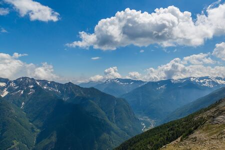 Swiss Maggia valley from above in Ticino, clouds, blue sky