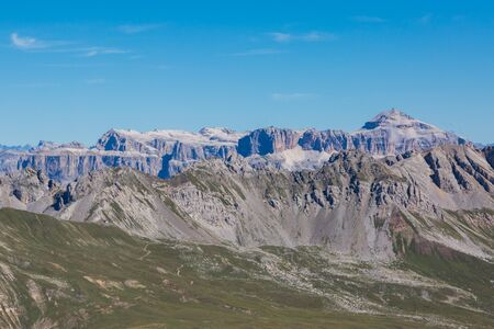 peaks of Sella group mountains in Dolomite with blue sky