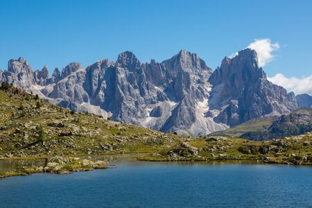blue lake and pala group mountain summits pale di san Martino in blue sky