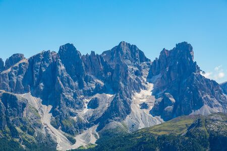 summits of pala group mountains pale di san Martino in blue sky