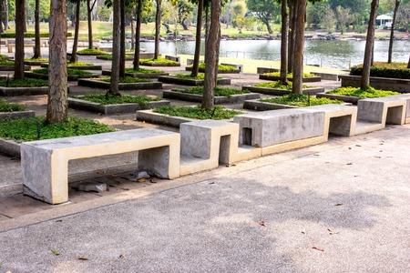 anti season: Modern stone Bench In the garden beside the road,Concrete bench,Cement bench Stock Photo