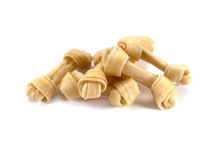rawhide: Pile of Rawhide dog treat isolated on white background