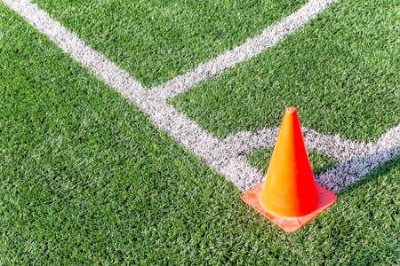 funnel: orange funnel on soccer field Stock Photo