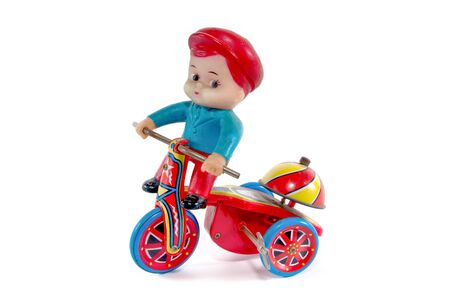 windup: Antique metal bicycle toy with boy toy isolated on white background