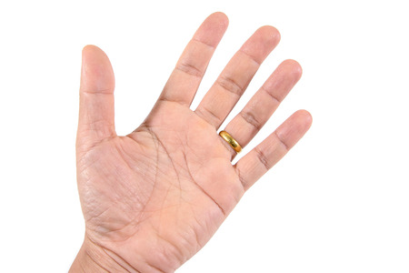 one hand: Detail of one hand with gold ring on white background