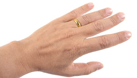 bridegroom: Wedding gold ring on hand of bridegroom concept on white background