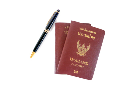 foreign nation: Thailand passport with a pen isolated on white background