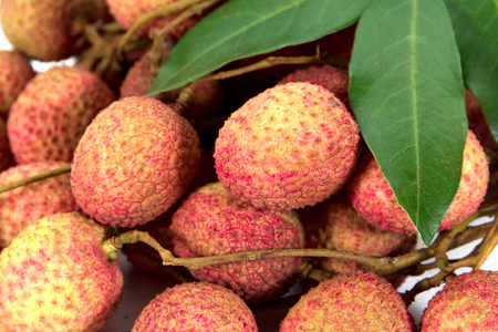 lychees: Closeup of lychees with leaves background texture