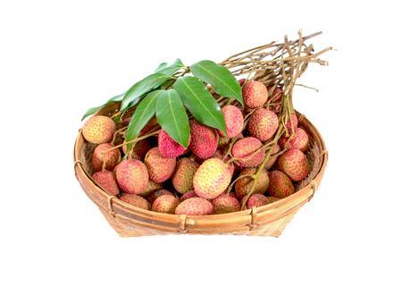 Fresh lychees fruit in bamboo basket isolated on white background Stock Photo
