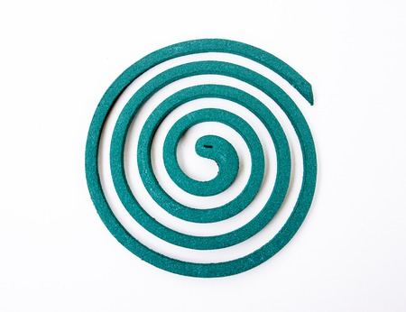 mozzie: Green mosquito coil spiral isolated on white background Stock Photo