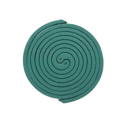 deterent: Mosquito repellent coil used on fire isolated on white background.Mosquito coil Stock Photo