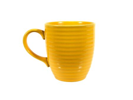 Yellow tea cup isolated on white background