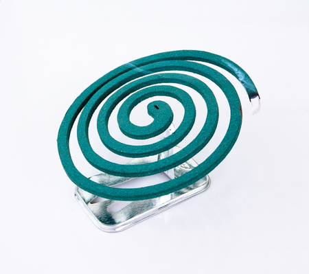 deterent: Mosquito coil with fire on metal stand isolated on white background.Mosquito repellent coil