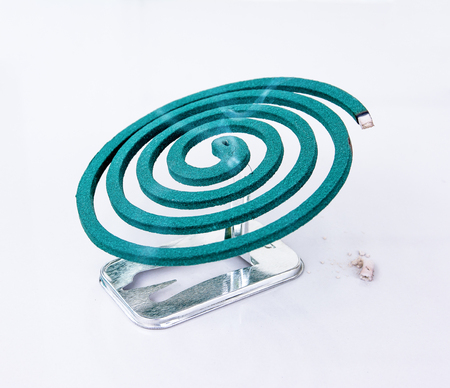 mozzie: Burning mosquito coil  with ash on metal stand.Mosquito repellent coil Stock Photo