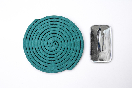 mozzie: Green mosquito coil with metal stand.Mosquito coil.Mosquito repellent coil Stock Photo