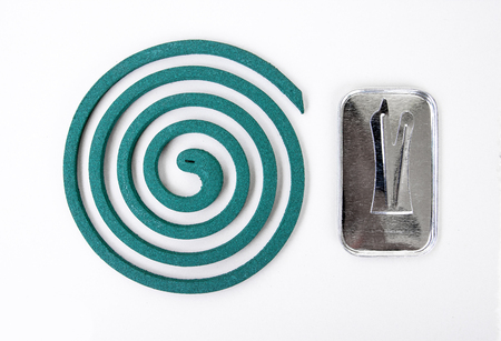 deterent: Mosquito repellent coil with metal stand.Mosquito coil Stock Photo