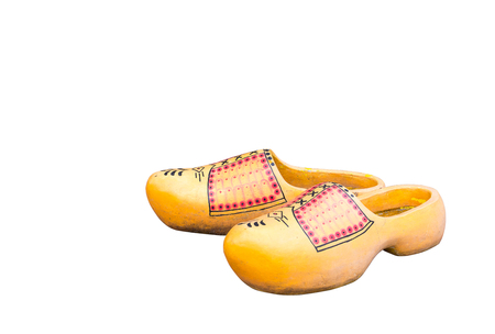 klompen: Pair of traditional Dutch yellow concrete shoes isolated on  white background.Holland clog shoes