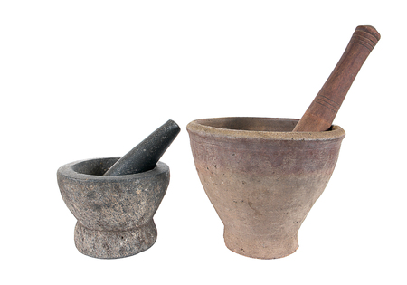 morter: Stone and clay mortar with wooden pestle isolated on white background Stock Photo
