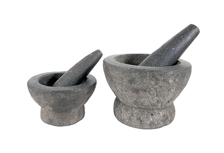morter: Stone mortar and pestle isolated on white background.Rock mortar