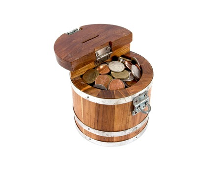 hoard: Round wooden money box with lock full with coins isolated on white background