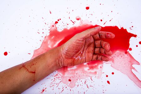 Bloody hand is smearing red blood on white background.Murder concept.Suicide concept