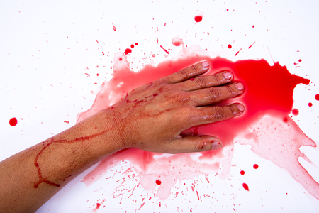 finger proof: Bloody hand smearing red blood on white background.Murder concept.Suicide concept Stock Photo