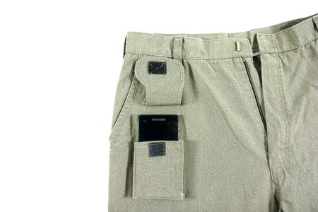 trouser: Green trouser front pocket opened with mobile phone inside