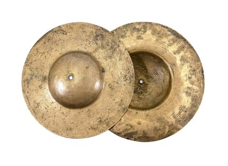 Cymbals: Closeup of old cymbals isolated on white background.Old cymbals isolated